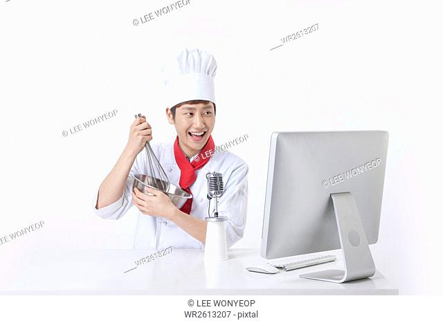 Portrait of young male cook broadcasting