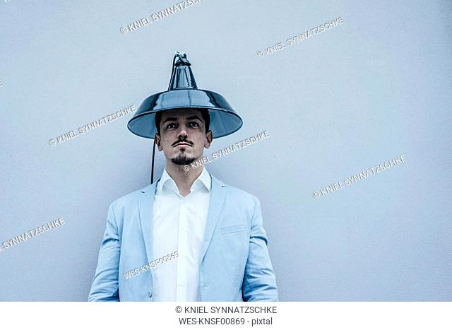Man wearing lampshade as hat