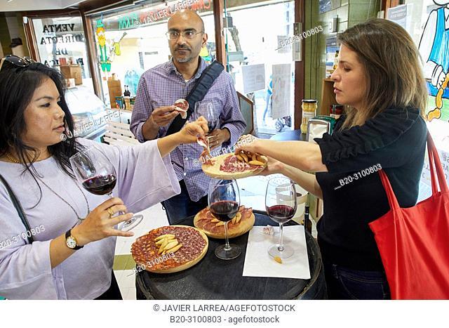 Tasting of ham, chorizo and loin iberico, Charcuterie, Gastronomic tour, guide with tourists, Donostia, San Sebastian, Gipuzkoa, Basque Country, Spain, Europe