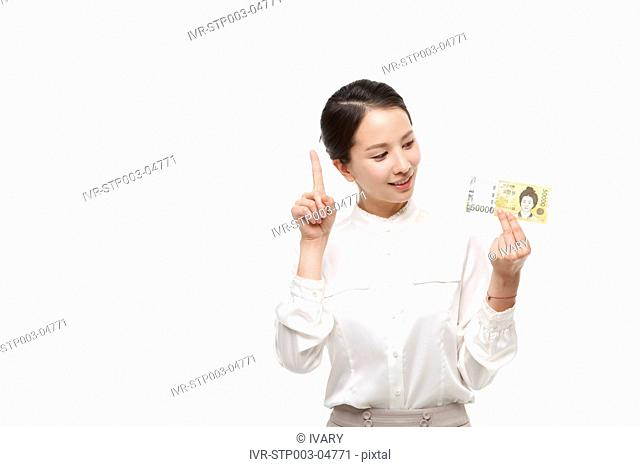 A young woman posing with paper money