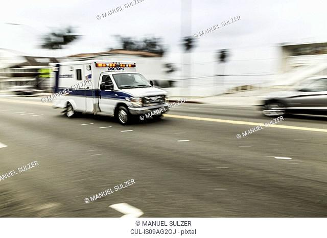 Blurred motion shot of speeding ambulance