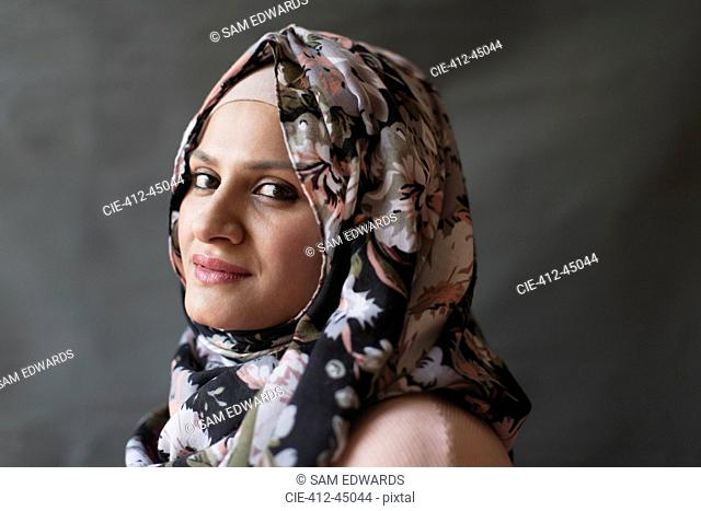 Portrait confident woman wearing floral hijab
