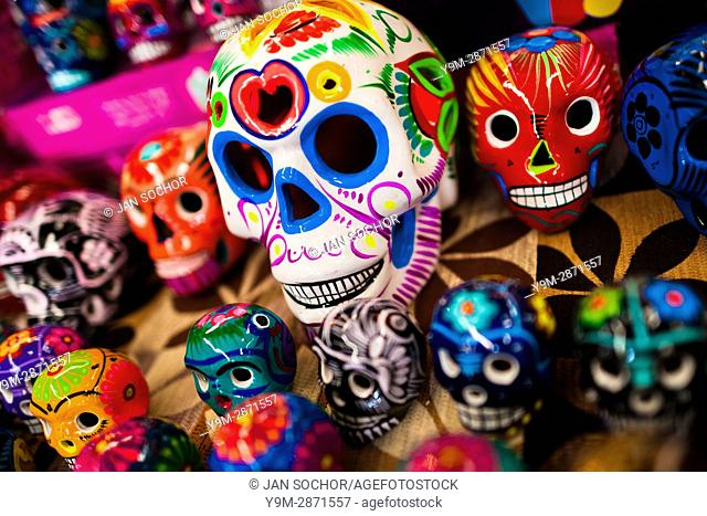 Colorful hand painted skulls are sold on the market during the Day of the Dead festivities in Mexico City, Mexico, 28 October 2016