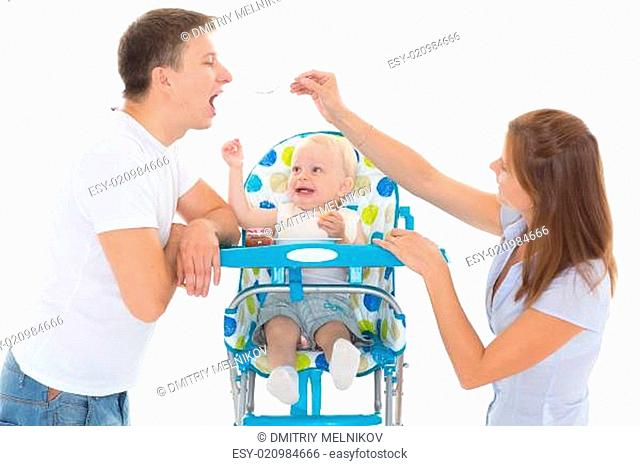 Young parents feed baby