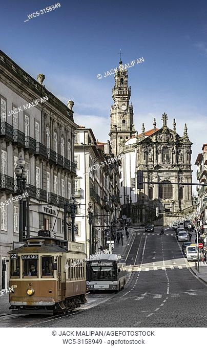 old town street view of porto portugal with tram and bus and landmark clerigos church