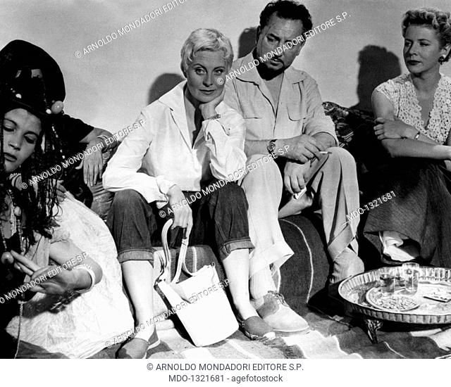 Michèle Morgan, Cornell Borchers and Pierre Brasseur in 'Oasis'. The French actors Michèle Morgan (Simone Renée Roussel) and Pierre Brasseur and the German...