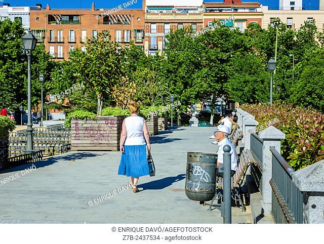 View of a woman with a blue skirt in a central square of Madrid city, Spain