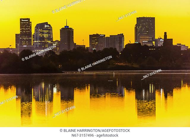 Sunrise at Sloans Lake with Downtown Denver in background, Colorado USA.. Sloan's Lake is the biggest lake in Denver, and at 177 acres