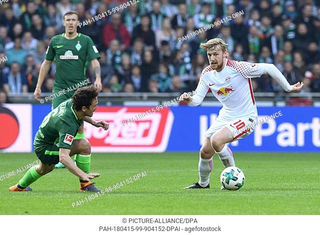 15 April 2018, Germany, Bremen: Football, German Bundesliga, Werder Bremen vs RB Leipzig at the Weserstadion. Leipzig's Emil Forsberg (r) and Werder's Thomas...
