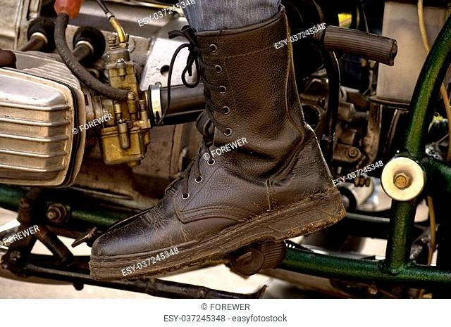 Biker foot on the pedal of gas on a motorcycle