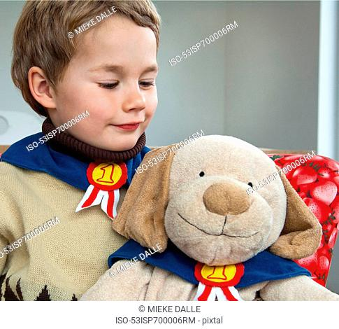 Boy playing with teddy bear