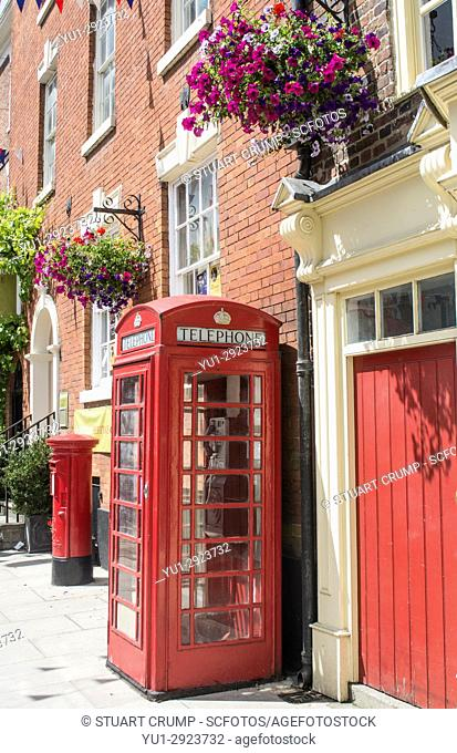 Traditional red telephone box and post box on Church Street in Ashbourne Derbyshire