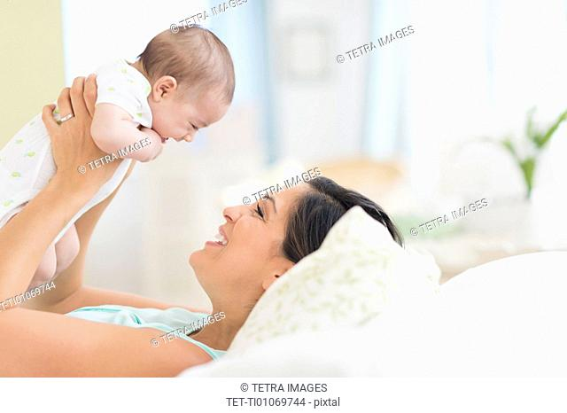 Mother playing with baby (2-5 months)