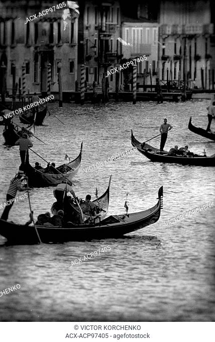 Gondolas carrying tourists on Grand Canal in Venice, Italy