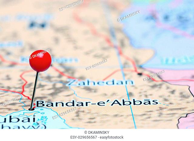 Photo of pinned Bandar Abbas on a map of Asia. May be used as illustration for traveling theme
