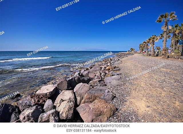Tourist walking in Las Americas coastline in Adeje, Tenerife, Spain. Las Americas is one of the most popular and touristic resorts, in Tenerife South area