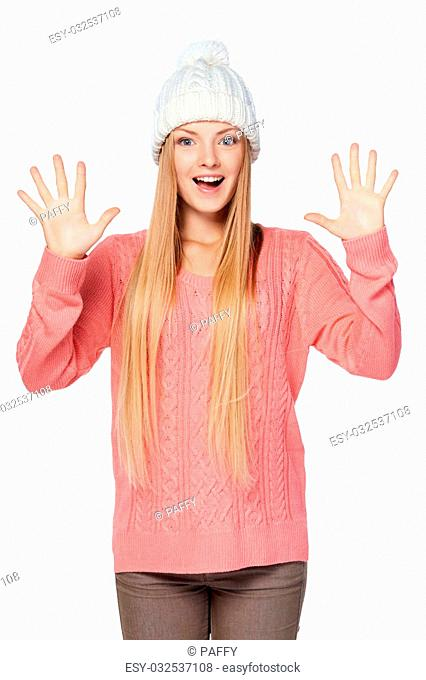 Hand counting - ten fingers. Aim goal achievement concept. Portrait of happy excited woman on white background wearing woolen hat and sweater showing ten...