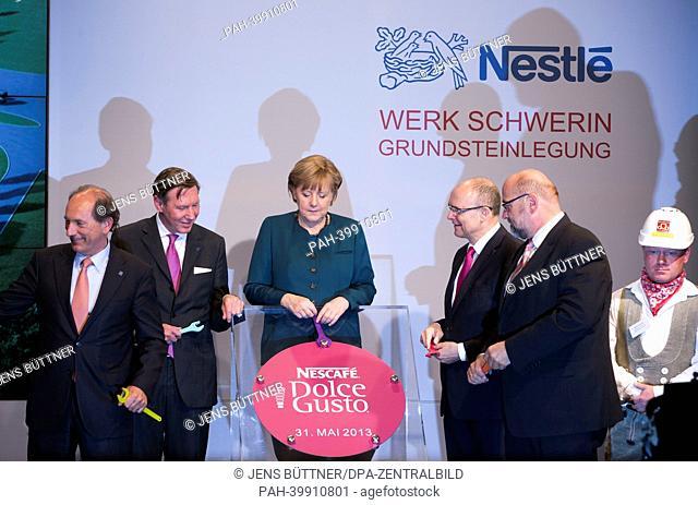 German Chancellor Angela Merkel (2-R), CEOof Nestlé Germany Gerhard Berssenbruegge (L), CEOof Nestlé Paul Bulcke (2-L) and Premier of Mecklenburg-Western...