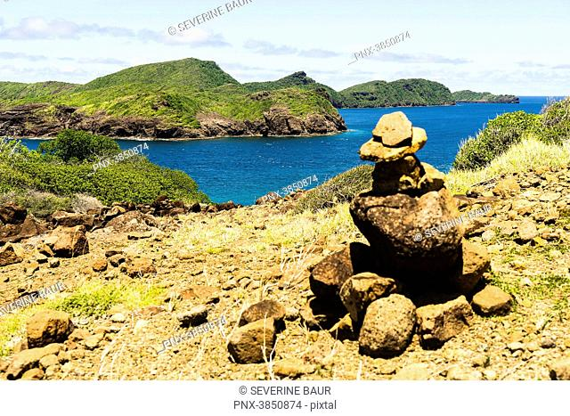 Stone cairn and view on sea, Petit Nevis, Saint-Vincent and the Grenadines, West Indies