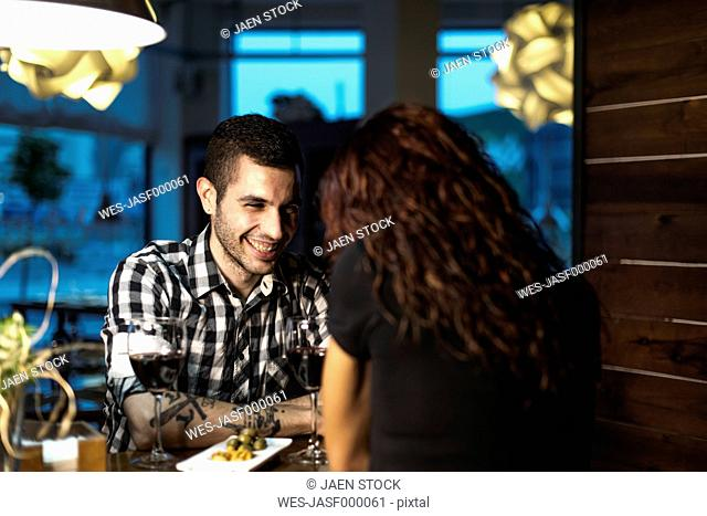 Couple in restaurant having dinner and drinking wine