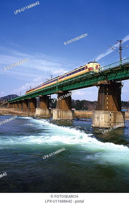 Limited Express Train Crossing The River