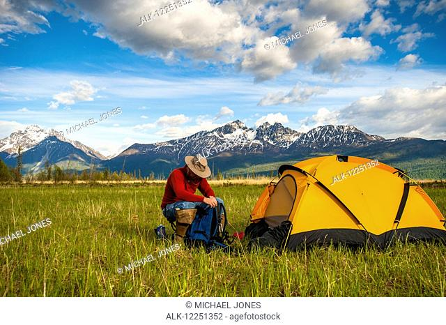 Man at his campsite in the Palmer Haystack Flats Wildlife Refuge near Rabbit Slough in Southcentral Alaska