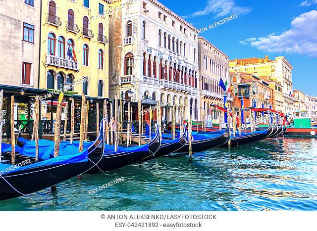 Gondolas moored near old palaces of Venice in the Grand Canal