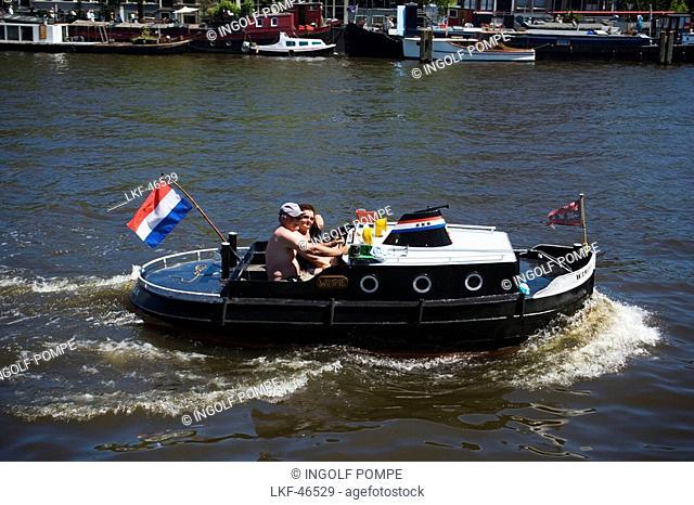 Leisure Boat, Magere Brug, Amstel, Couple in mini ocean liner on Amstel near of Magere Brug Skinny Bridge, Amsterdam, Holland, Netherlands