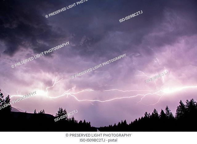 Lightning in sky over Canadian Rocky Mountains, Kootenay Region, Fernie, British Columbia, Canada
