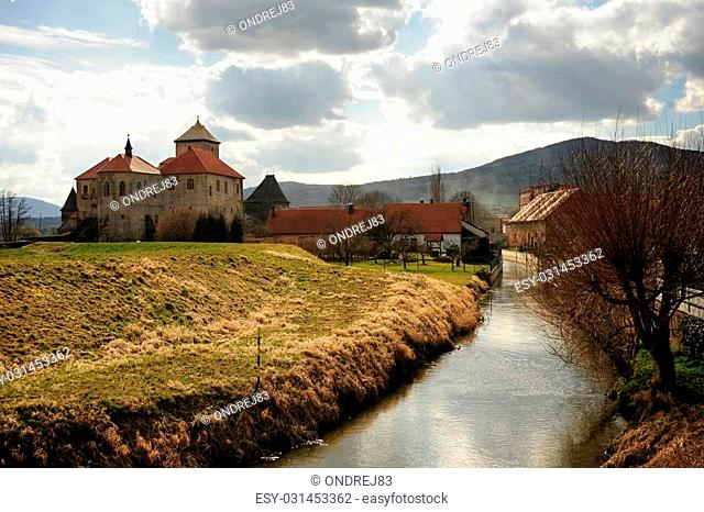 Very old castle with spring countryside in Bohemia