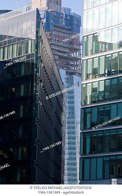 The Shard skyscaper during construction viewed from through office buildings in Southwark,London
