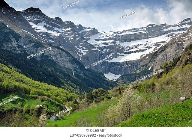 Gavarnie is a small village in the mountain valley of the river Gave de Pau. In the background there is a famous rock amphitheater