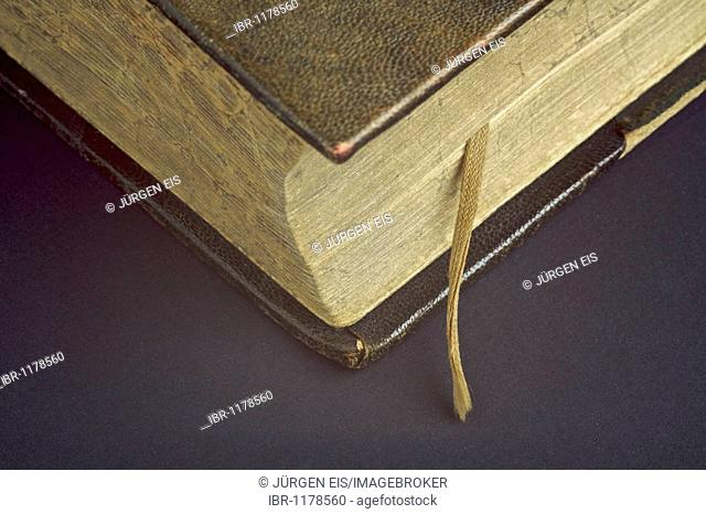 One hundred years old Bible with a worn ribbon