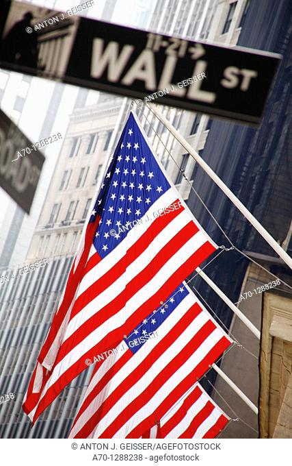 New York City, wall street stock exchange building with american flag