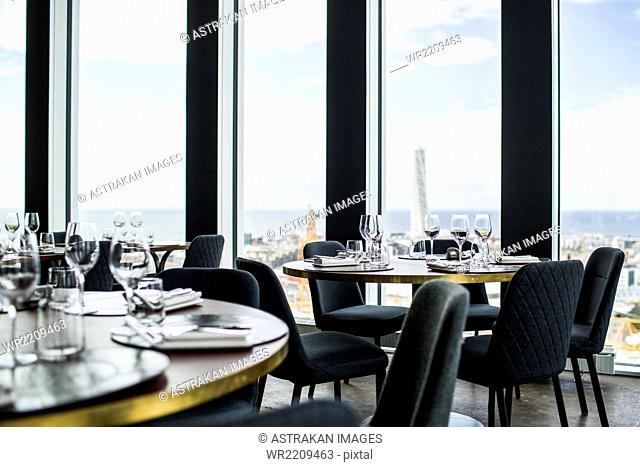 Tables and chairs arranged in Skybar restaurant