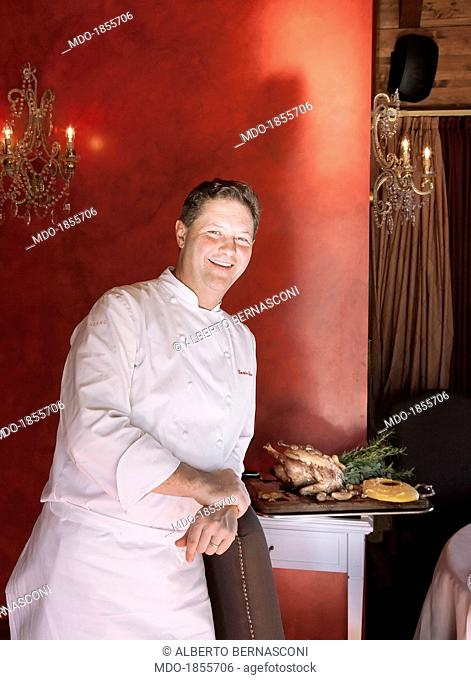 Italian chef Enrico Cerea known as Chicco leaning on the back of a chair in a photocall shooted at his restaurant awarded with three Michelin stars 'Da...