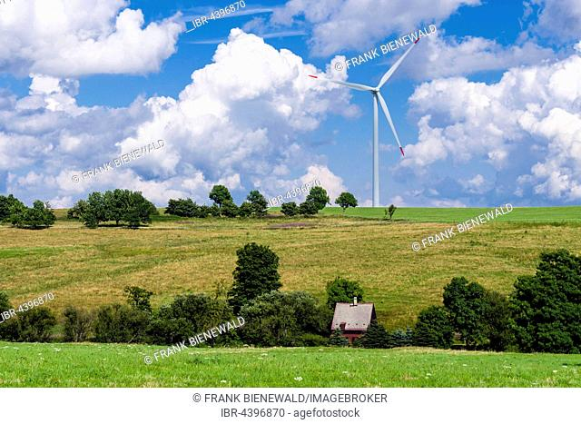 Wind power plant and a little house in agricultural landscape, Hermsdorf, Saxony, Germany