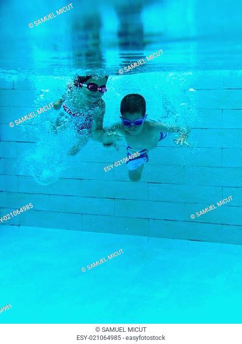 Girl and boy underwater