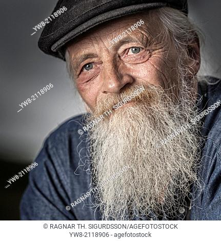 Portrait of senior man with a beard