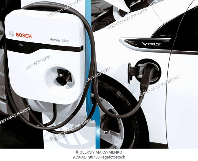 Chevrolet Volt hybrid electric car plugged in into a charging station