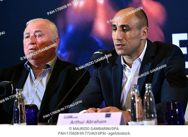 Ulli Wegner, trainer of Arthur Abraham (L), partakes in a press conference before the Super middleweight IBO boxing match against Eubank Jr
