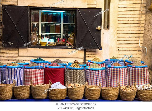 bags with grains and other articles in front of shop in medina in Marrakech, Maroc