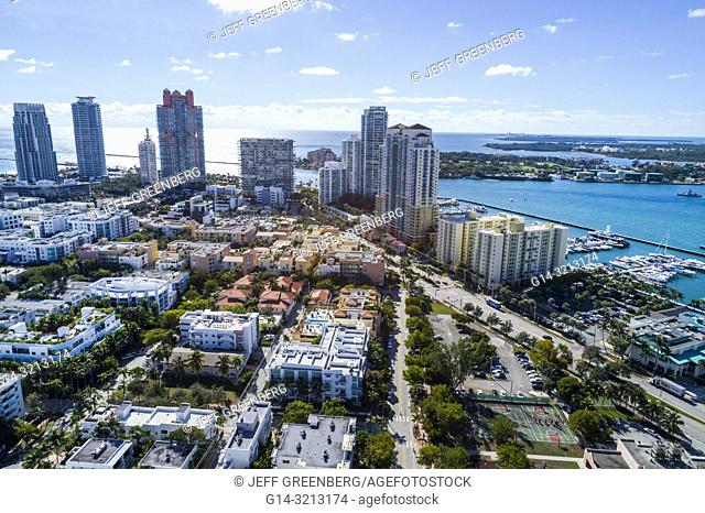 Florida, Miami Beach, aerial view, South Pointe, Murano Portofino, high rise condominium buildings, The Yacht Club at Portofino, Apogee Continuum, Biscayne Bay