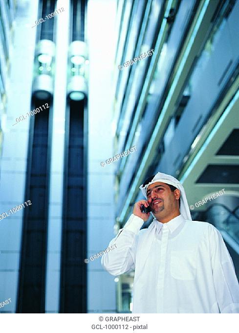 Arab businessman using cell phone