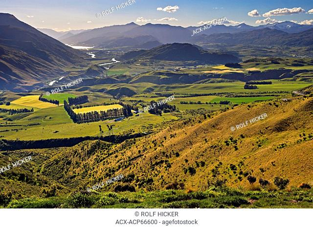 Paddocks and farmland in the Kawarau River Valley near Queenstown seen from the Crown Range Road, Central Otago, South Island, New Zealand
