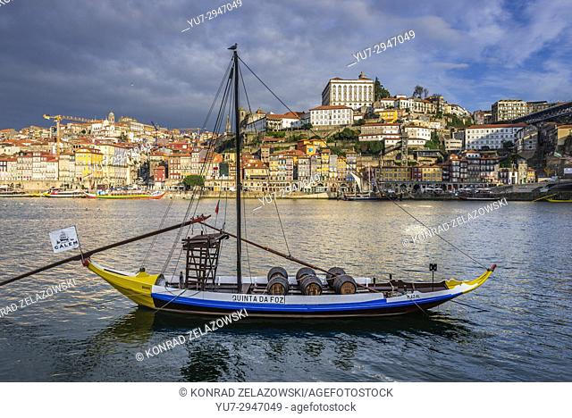 Calem Port wine boat called Rabelo Boat on a Douro River in Vila Nova de Gaia city. Porto city river bank on background