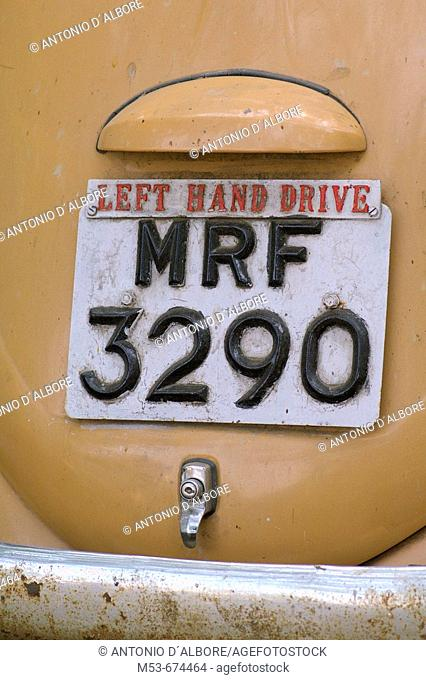 Plate with additional 'left hand drive' sign on an abandoned car in Santacruz district, Mumbai, Maharashtra, India