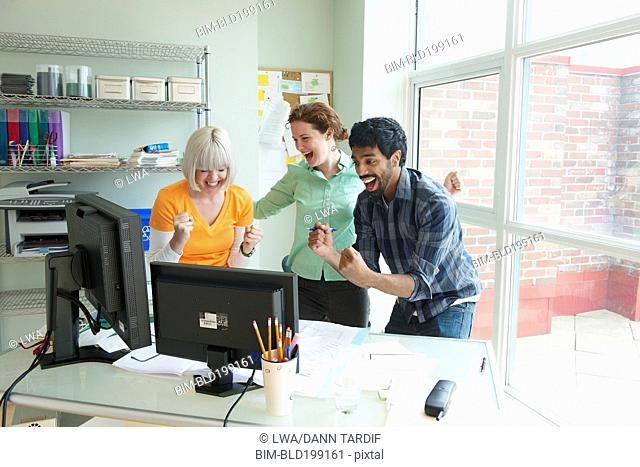 Excited business people working together in office