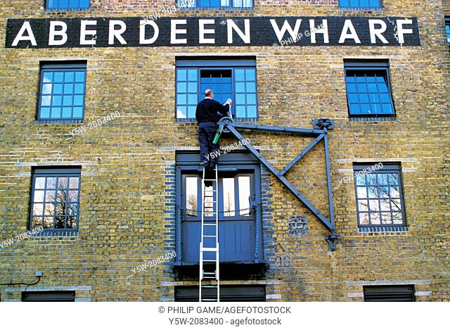 London, England. Victorian-era riverside warehouses in Rotherhithe on the south bank of the Thames
