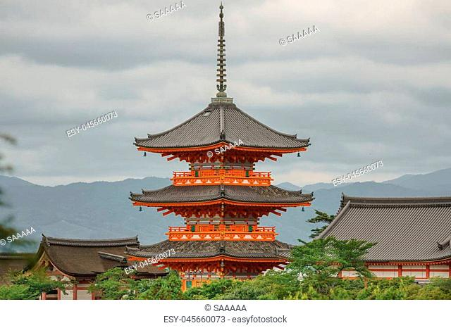 Skyline with Japanese pagoda over the trees